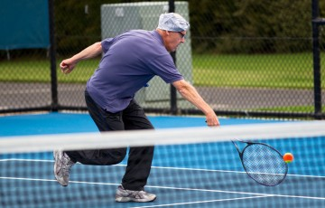 17th of March 2011. Rob Kilderry enjoys a Cardio Tennis session at the Australian Tennis Conference. Mark Riedy.