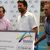 The tennis community donates to the Premier's Relief Appeal (l to r:) Queensland Minister for Sport Phil Reeves, Pat Rafter and Ashley Cooper. Photo: Tennis Queensland