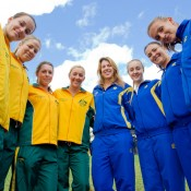 The Australian and Ukraine teams gather for a team shot at the official draw by the Yarra River in Melbourne.