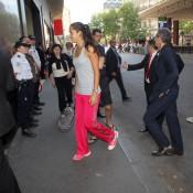 Ana Ivanovic arrives through a side entrance. Ron Angle.
