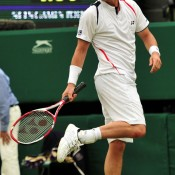 Former Wimbledon champ Lleyton Hewitt ignored a sore foot to fight his way through to the second round where Robin Soderling tripped him up in five. AFP