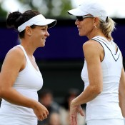 Australian favourites Casey Dellacqua (left) and Rennae Stubbs succumbed in straight sets in the first round of the women's doubles championships. GETTY IMAGES