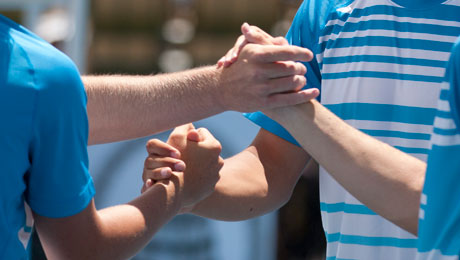 Players shake hands. KARA TYSON