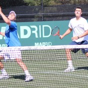 Synchronised smashing: Matt Ebden (left) prepares to smash while Bernard Tomic waits back in support. TENNIS AUSTRALIA