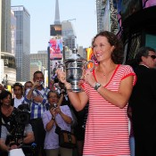 Australian tennis player Sam Stosur with her US Open trophy in Times Square. Getty Images