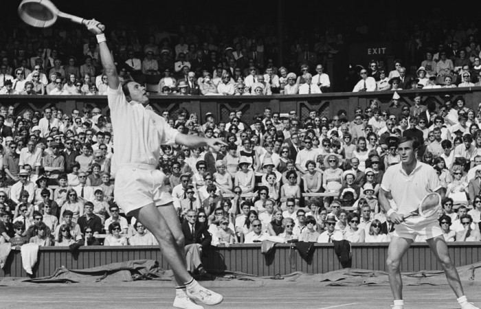 Ken Fletcher (left) flies for a smash while John Newcombe looks on. HULTON ARCHIVE