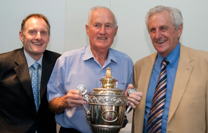 Author Richard Naughton, Wimbledon champion Neale Fraser and Sir Norman Brookes's grandson Norman Gengoult-Smith with Brookes' Wimbledon trophy. MAE DUMRIGUE