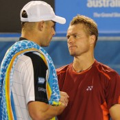 Lleyton Hewitt commiserates with Andy Roddick (left) after the American retired during their second-round match. AFP