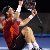 Lleyton Hewitt falls to the court after overcoming Germany's Cedrik-Marcel Stebe in the first round. GETTY IMAGES