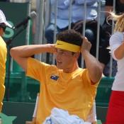 Bernard Tomic listens to Australian Davis Cup captain Patrick Rafter: Kim Trengove