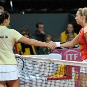 Jarmila Gajdosova and Stefanie Voegel shake hands. FRESHFOCUS