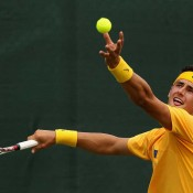 Bernard Tomic serves to Wu Di in the second singles rubber at Geelong: Getty Images
