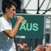 Bernard Tomic has a drink at practice: Tennis Australia