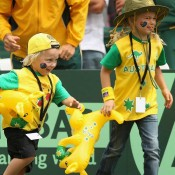 Cruz and Mia Hewitt celebrate their father, Lleyton's singles success on Day One: Getty Images