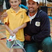 Pat Rafter congratulates a young student at Torquay College during a Hot Shots class: Tennis Australia