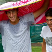 Daniel Guccione (left) and Thanasi Kokkinakis do their best to avoid the rain in Bendigo. MARK RIEDY