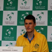 Bernard Tomic greets the press following his reverse singles against Korea at the Davis Cup tie in Brisbane: Getty Images
