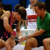 Sam Stosur and Fed Cup captain David Taylor make some last-minute preparations before Stosur takes to the court against Angelique Kerber; Getty Images