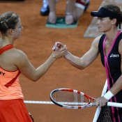 Kerber (L) and Stosur shake hands after Stosur recorded a 7-6(1) 6-4 victory to hand Australia an early 1-0 lead in the tie; Getty Images