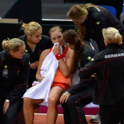 Kerber is consoled by her German teammates following her loss to Stosur; Getty Images