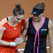 Andrea Petkovic (L) and Sam Stosur shake hands after their match; Getty Images
