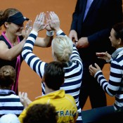 Sam Stosur celebrates with her Aussie teammates after winning against Andrea Petkovic; Getty Images