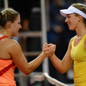 Angelique Kerber (L) and Olivia Rogowksa shake hands following their match, which Kerber won 6-3 6-3; Getty Images