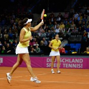 Casey Dellacqua plays a forehand as partner Jarmila Gajdosova watches on; Getty Images