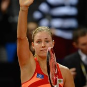Angelique Kerber waves to the crowd following her defeat of Olivia Rogowska; Getty Images