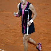 Sam Stosur of Australia celebrates after winning against Andrea Petkovic, a victory that sealed an unassailable 3-0 lead for the Aussies and returns them to the World Group; Getty Images