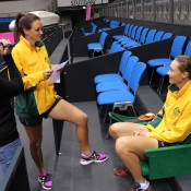 Following a practice session, Casey Dellacqua (L) turns her hand to a media role in interviewing teammate Sam Stosur; Tennis Australia