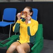 Sam Stosur gets up close and personal with a pretzel; Tennis Australia