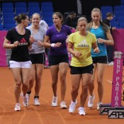 The German team of (L-R) Andrea Petkovic, Anna-Lena Groenefeld, Julia Goerges, Angelique Kerber and Mona Barthel warm up together before a practice session; Tennis Australia