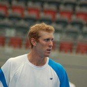Chris Guccione practises at the Queensland Tennis Centre, Brisbane.