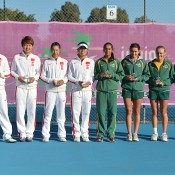 Australia's Junior Fed Cup team (R) at the post-match presentation with the Chinese team following the Asia/Oceania qualifying competition final; Bill Conroy