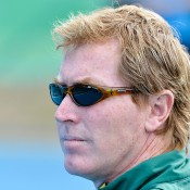 Junior Davis Cup captain Mark Woodforde looks on during the Australia v Japan final; Bill Conroy