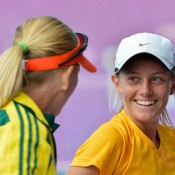 Junior Fed Cup captain Nicole Pratt congraulates Zoe Hives on her singles win; Bill Conroy