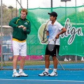 Li Tu receives advice from Junior Davis Cup captain Mark Woodforde at an Australian team practice session; Tennis Australia