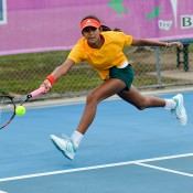 Naiktha Bains runs for a forehand during her win against Malaysia's Choo Lyn Yuen in Australia's second match of their Junior Fed Cup qualifying campaign; Bill Conroy