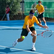 Thanasi Kokkinakis hits a volley in the doubles rubber of Australia's Junior Davis Cup tie against New Zealand; Bill Conroy