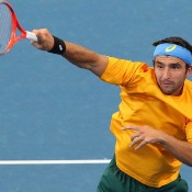 Marinko Matosevic serves during the Davis Cup doubles rubber between Australia and Korea.