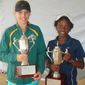 Benard Nkomba (R) and Aleksa Cveticanin pose with their trophies after claiming the Optus 12s National Claycourt Championships singles titles in Ipswich, Queensland; Tennis Australia