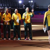 The Australian team in good spirits as Sam Stosur is introduced to the court prior to their Fed Cup tie against Germany; Tennis Australia