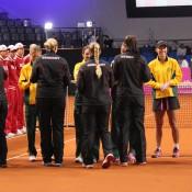 The Australian and German teams swap Fed Cup pennants prior to their tie in Stuttgart; Tennis Australia