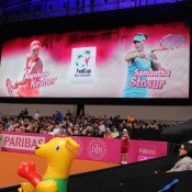 The giant screen at Porsche Arena signals the upcoming match, watched diligently my Australia's inflatable kangaroo mascot; Tennis Australia