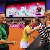 Jarmila Gajdosova is congratulated by her Aussie teammates after defeating Julia Goerges to put Australia 2-0 up; Tennis Australia