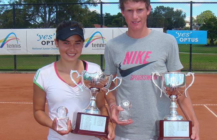 Isabelle Wallace (L) and Harry Bourchier hold their trophies after winning the singles titles at the Optus 16s National Claycourt Championships in Ipswich; Tennis Australia