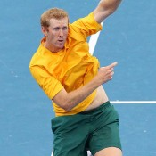 Chris Guccione reaches for a smash during the doubles of the Davis Cup tie against Korea in Brisbane: Getty Images