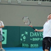 Lleyton Hewitt watches Todd Woodbridge at the Davis Cup practice session in Brisbane.
