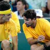 Bernard Tomic consults Pat Rafter during his singles match at the Davis Cup tie in Brisbane between Australia and Korea: Getty Images